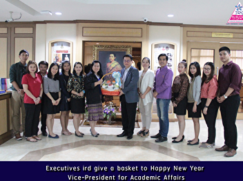Executives ird give a basket to Happy New Year Vice-President for Academic Affairs
